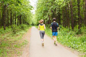 Running together - friends jogging in park