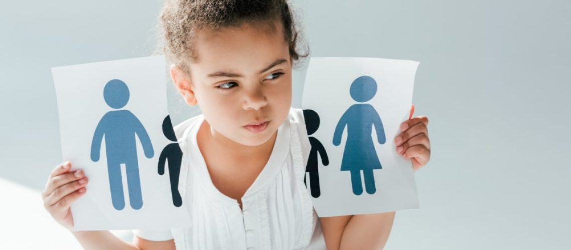 african american kid holding ripped paper with family on white, divorce concept