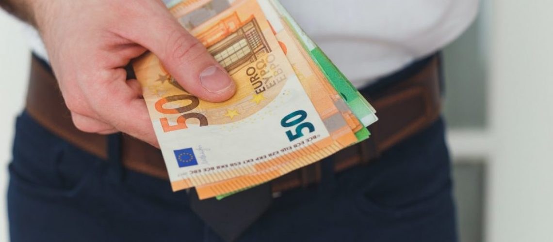 Detail of man hands with money, euro notes