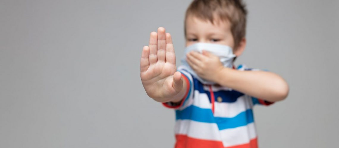 Young child wearing a respiratory mask as a prevention against the Coronavirus Covid-19